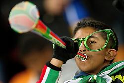 20-06-2010 VOETBAL: FIFA WORLDCUP 2010 BRAZILE - IVOORKUST: JOHANNESBURG <br /> Support publiek Brazil fan blaast op de vuvuzela <br /> ©2010-FRH- NPH/ Vid Ponikva (Netherlands only)