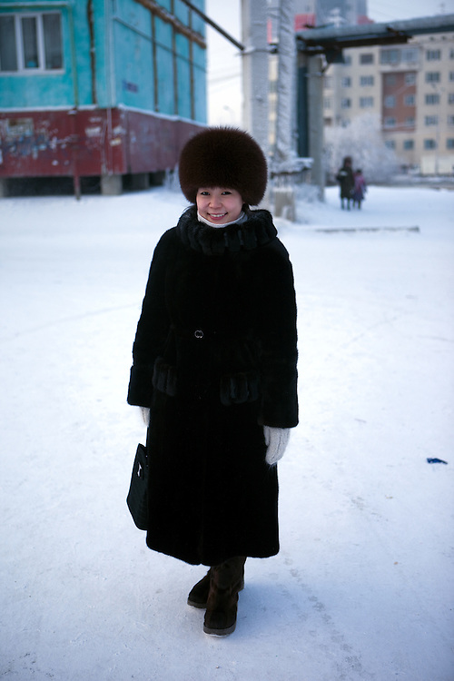 Portrait of a Yakutian woman in the streets of Yakutsk. Yakutsk is a city in the Russian Far East, located about 4 degrees (450 kilometres) south of the Arctic Circle. It is the capital of the Sakha (Yakutia) Republic in Russia with a major port on the Lena River. The city has a population of 264.000 (2009). Yakutsk is one of the coldest cities on Earth. The average monthly winter temperature in January is around -43,2 C. Yakutsk, Jakutsk, Yakutia, Russian Federation, Russia, RUS, 15.01.2010.