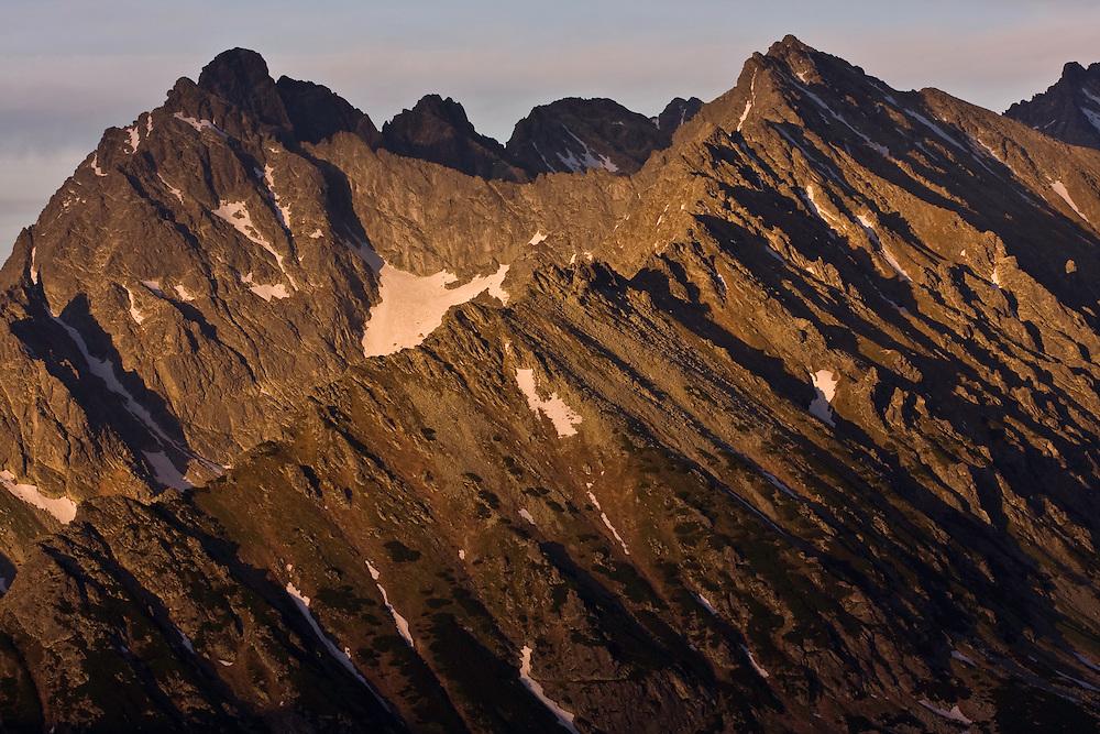 Mount Koprovsky stit (2363m asl) and Mengusovsky stit (2438m als) at sunset. High Tatras, Slovakia. June 2009. Mission: Ticha