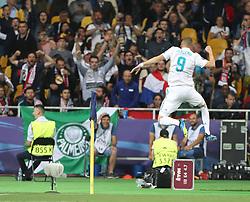 May 26, 2018 - Kiev, Ukraine - Karim Benzema of Real Madrid celebrates scoring a goal during the UEFA Champions League Final between Real Madrid and Liverpool at NSC Olimpiyskiy Stadium on May 26, 2018 in Kiev, Ukraine. (Credit Image: © Raddad Jebarah/NurPhoto via ZUMA Press)