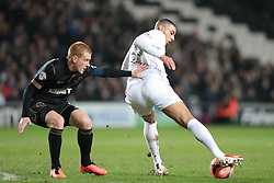 Milton Keynes Dons' Daniel Powell controls the ball away from Wigan Athletic's Ben Watson - Photo mandatory by-line: Nigel Pitts-Drake/JMP - Tel: Mobile: 07966 386802 14/01/2014 - SPORT - FOOTBALL - Stadium MK - Milton Keynes - MK Dons v Wigan Athletic - FA Cup - Third Round replay