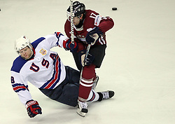 Phil Kessel (8) and Aleksandrs Nizivijs (17) at ice-hockey match USA vs Latvia at IIHF WC 2008 in Halifax,  on May 02, 2008 in Metro Center, Halifax, Canada.  (Photo by Vid Ponikvar / Sportal Images)