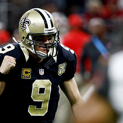 Dec 24, 2016; New Orleans, LA, USA; New Orleans Saints quarterback Drew Brees (9) celebrates after a two point conversion during the second half of a game against the Tampa Bay Buccaneers at the Mercedes-Benz Superdome. The Saints defeated the Buccaneers 31-24.  Mandatory Credit: Derick E. Hingle-USA TODAY Sports