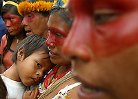 A group of Huaorani Indian women chant songs using the names of their dead ancestors during a protest against Texaco outside of the court house in Lago Agrio, in northern Ecuador, on Tuesday October 21, 2003. Residents of Lago Agrio and neighboring towns, including many indigenous communities, claim that the U.S. oil company Texaco is responsible for contaminating the region during their years of operating the oil fields in the region. They are arguing in court that the contamination caused environmental damage and numerous cases of cancer and other illnesses throughout the area. (Photo/Scott Dalton)