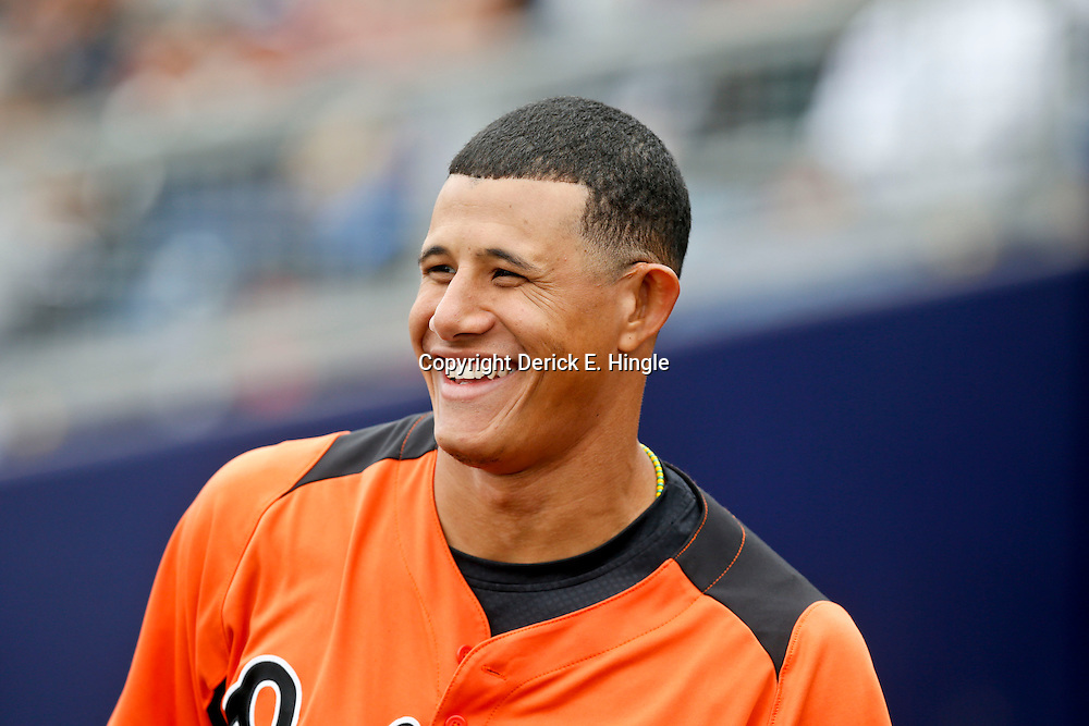 Mar 2, 2013; Port Charlotte, FL, USA; Baltimore Orioles third baseman Manny Machado (13) smiles in the dugout during the top of the fifth inning of a spring training game against the Tampa Bay Rays at Charlotte Sports Park. Mandatory Credit: Derick E. Hingle-USA TODAY Sports