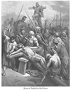 Nailing Christ to the Cross [John 19:18-19] From the book 'Bible Gallery' Illustrated by Gustave Dore with Memoir of Dore and Descriptive Letter-press by Talbot W. Chambers D.D. Published by Cassell & Company Limited in London and simultaneously by Mame in Tours, France in 1866