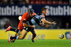 Tavis Knoyle (Blues) drops the ball after being tackled by Julian Salvi (Leicester) - Photo mandatory by-line: Patrick Khachfe/JMP - Mobile: 07966 386802 29/08/2014 - SPORT - RUGBY UNION - Leicester - Welford Road - Leicester Tigers v Cardiff Blues - Pre-Season Friendly