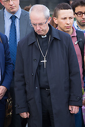 Parliament Square, Westminster, London, June 17th 2016. Following the murder of Jo Cox MP a vigil is held as friends and members of the public lay flowers, light candles and leave notes of condolence and love in Parliament Square, opposite the House of Commons. PICTURED: Archbishop of Caterbury Justin Wellby visits the scene.
