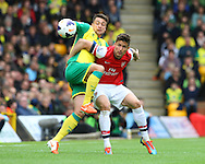 Russell Martin of Norwich and Olivier Giroud of Arsenal in action during the Barclays Premier League match at Carrow Road, Norwich<br /> Picture by Paul Chesterton/Focus Images Ltd +44 7904 640267<br /> 11/05/2014
