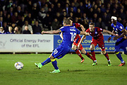 AFC Wimbledon midfielder Dean Parrett (18) scoring penalty 3-0 during the EFL Sky Bet League 1 match between AFC Wimbledon and Rochdale at the Cherry Red Records Stadium, Kingston, England on 28 March 2017. Photo by Matthew Redman.