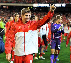 MELBOURNE, AUSTRALIA - Wednesday, July 24, 2013: Liverpool's captain Steven Gerrard waves to the supporters after a 2-0 victory over Melbourne Victory during a preseason friendly match at the Melbourne Cricket Ground. (Pic by David Rawcliffe/Propaganda)