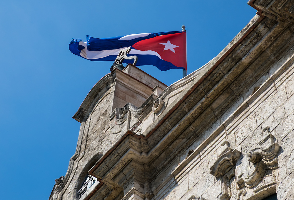 "HAVANA, CUBA - CIRCA MAY 2016: Cuban Flag over the ""Palacio De los Capitanes Generales"" in Havana."