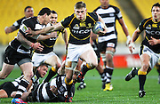Lions' Jason Woodward on the attack as Hawke's Bay's Zac Guildford looks to make the tackle during the 2012 ITM Cup rugby session - Wellington Lions v Hawke's Bay at Westpac Stadium, Wellington, New Zealand on Tuesday 28 August 2012. Photo: Justin Arthur / photosport.co.nz