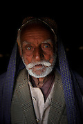 A portrait of Hamzio Babar, age 90, who's whole family enslaved for 14 years for borrowing US$143. <br /> <br /> Following the release of the Global Slavery Index by the Walk Free Foundation Pakistan is ranked 3rd worse in the world behind India and China. The Asian Development Bank estimates some 1.8 million people are slaves in Pakistan yet other estimates reach up to 4 million people, most of which toil year after year in brick kilns or sugar cane plantations. Their stories are the same; they have no-where to turn so they borrow money from a land-owner for a medical emergency or marriage dowry. The landlords pay in return for work, their labour supposed to be taken off the amount borrowed. Yet after years of no salary incredibly their amount owed is often quadrupled, the excuse being the amount they cost to feed! Many are chained, abused, raped and even killed.<br /> <br /> For years they had no where to run, no one to help but now a small local NGO called the Green Development Rural Organisation (GDRO) works to free bonded-slaves by using the law against their captives. Yet, often freed slaves end up right back where they were or risk being hunted by the landowner and forced to return. So GRDO started building villages so slaves who escape or are freed have somewhere safe to go. It now has two, whose names translate from Urdu as 'Village of the Freed' and 'Village of the Courageous', and is working on a 3rd. The land is bought and allocated to freed slave families where they can built a house and start again. Without such help the vicious cycle would continue.