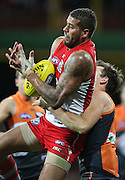 Lance Franklin of the Swans beats Phil Davis of the Giants to a mark during the 2014 AFL Round 15 match between the Sydney Swans and the GWS Giants at the SCG, Sydney on June 28, 2014. (Photo: Craig Golding/AFL Media)