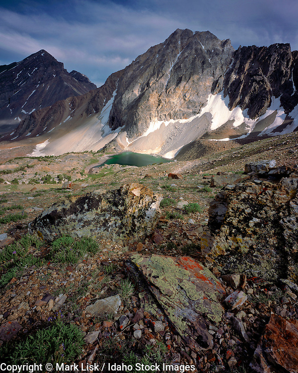 The sun highlights patches of Leatherman Peak above Pass Lake in the Lost River Mountain Range, Idaho.