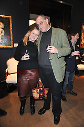 WILLIE & CHARLOTTE STIRLING at a party to celebrate the publication of The irish Country House written by The Knight of Glin and James Peill with photographs by James Fennell, held at Christie's, King Street, London on 24th January 2011.