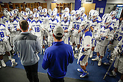 SHOT 2/18/17 12:47:55 PM - Air Force head lacrosse coach Eric Seremet (in blue) in the locker room before playing against Marist College at Falcon Stadium at the Air Force Academy in Colorado Springs, Co. Marist won the game 10-4. Seremet is in his ninth season as the head coach for the Air Force lacrosse program.<br /> (Photo by Marc Piscotty / © 2017)