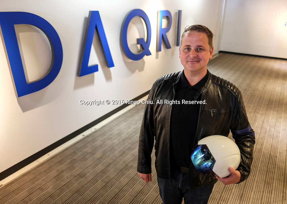 Brian Mullins of Daqri, with their smart helmet.(Photo by Ringo Chiu/PHOTOFORMULA.com)<br /> <br /> Usage Notes: This content is intended for editorial use only. For other uses, additional clearances may be required.