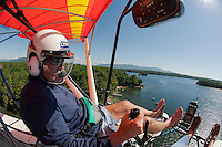 Keith Markley takes in the view of Black Cat Island (off to the right) on Lake Winnipesaukee in Center Harbor Bay from his two seater Quicksilver Seaplane on Friday morning.  (Karen Bobotas/for the Laconia Daily Sun)
