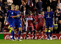 Photo: Jed Wee.<br />Middlesbrough v Manchester Utd. The Barclays Premiership. 29/10/2005.<br /><br />Middlesbrough celebrate their third goal with Yakubu (C) as Manchester United players troop back to the centre circle.