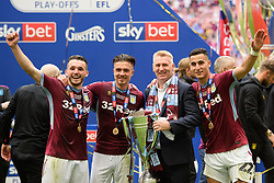 May 27, 2019 - London, England, United Kingdom - JohnMcGinn (7) of Aston Villa, Jack Grealish (10) of Aston Villa, Aston Villa Manager Dean Smith and Anwar El Ghazi (22) of Aston Villa celebrate with the trophy during the Sky Bet Championship match between Aston Villa and Derby County at Wembley Stadium, London on Monday 27th May 2019. (Credit: Jon Hobley | MI News) (Credit Image: © Mi News/NurPhoto via ZUMA Press)