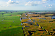 Nederland, Overijssel, Gemeente Steenwijkerland, 10-10-2014; Nationaal Park De Weerribben, het landschap is het resultaat van het winnen van turf waardoor 'trekgaten' ontstonden. De legakkers ('ribben') werden gebruikt voor het drogen van de turf. Tegenwoordig vindt er rietteelt plaats (dekriet). De rook is het gevolg van het branden van rietvelden en wordt toegepast om het riet wat door intensief maaien verruigd is en door ziekte is aangetast, weer nieuw leven in te blazen. <br /> The National Park Weerribben. The landscape is the result of the extraction of peat, after digging the peat (creating the 'pull holes'), it was to layed to dry on fields (the 'ribs'). Today production of reed takes place (thatching), the smoke was caused by burning cane fields The controlled burning of the reed fields to renew the reed.<br /> luchtfoto (toeslag op standard tarieven);<br /> aerial photo (additional fee required);<br /> copyright foto/photo Siebe Swart