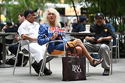 A Pro-Trump supporter sits inside the IBM Plaza atrium during Presdident Trump's press conference inside Trump Tower in New York, NY, on August 15, 2017. President Trump has been met with daily Anti-Trump rallies outside his residence, where he is staying for the first time since taking office.(Photo by Anthony Behar)