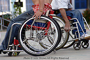 Confined to their wheelchairs, patients at The National Rehabilitation Center (NRC) display strength and speed while playing a game of basketball in Vientiane, Laos.  Many of the patients at the NRC are UXO victims or suffer degenerative diseases due to poor rural health care.