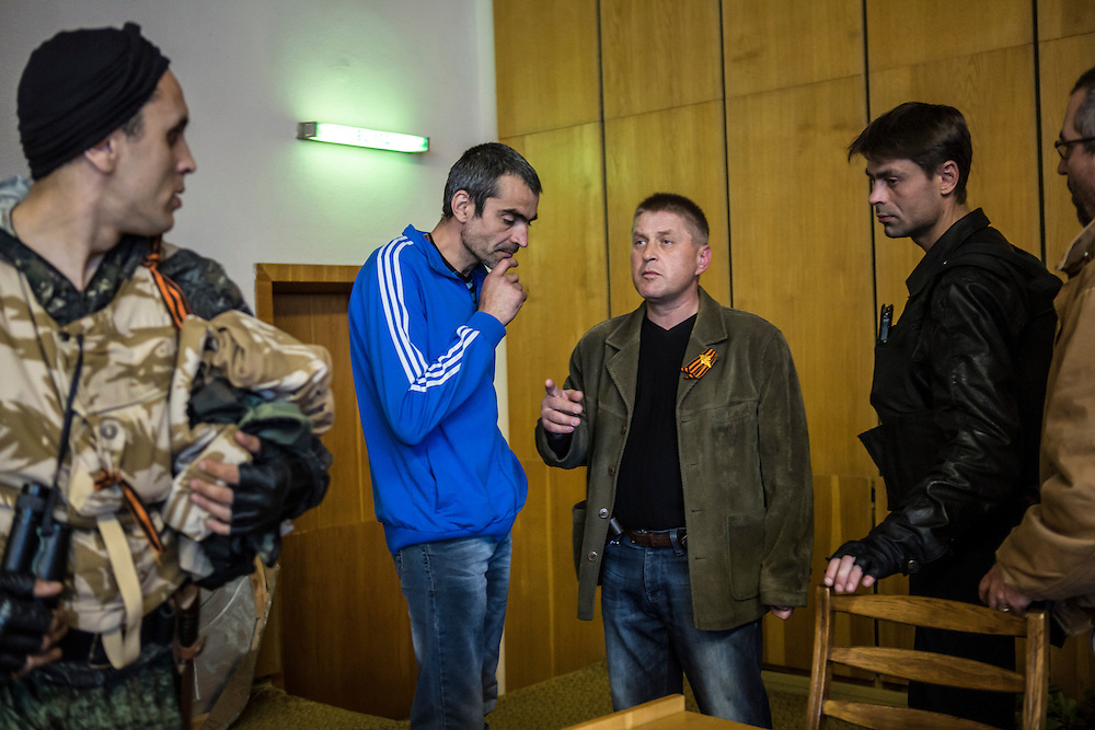 SLOVYANSK, UKRAINE - APRIL 24:  Vyachislav Ponomaryov (C), the self-appointed pro-Russian separatist mayor of the city of Slovyansk, talks to reporters and aides following his daily news conference on April 24, 2014 in Slovyansk, Ukraine. Pro-Russian activists have been occupying government buildings and demanding greater autonomy in many Eastern Ukrainian cities in recent weeks, prompting the government in Kiev to threaten military action to retake control of the cities. (Photo by Brendan Hoffman/Getty Images) *** Local Caption *** Vyachislav Ponomaryov