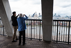 © Licensed to London News Pictures. 14/06/2016. London, UK. Two men take in the view from the top floor of the Switch House, the new Tate Modern building which opens to the public on Friday 17 June 2016. The ten-storey extension was designed by architects Herzog & de Meuron and includes the world's first gallery space dedicated exclusively to live art, film and installations. Photo credit: Rob Pinney/LNP