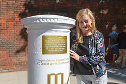 Claire Jackson, Head of Communications for the ECB for the ECB poses with the white-painted postbox as Royal Mail unveils a postbox outside Lords Cricket Ground with a plaque and graphics that celebrate England's ICC Cricket World Cup Victory. London, July 16 2019.