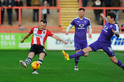 Jake Taylor (25) of Exeter City crosses the ball as Glen Rea (16) of Luton Town comes in to tackle him during the EFL Sky Bet League 2 match between Exeter City and Luton Town at St James' Park, Exeter, England on 26 November 2016. Photo by Graham Hunt.
