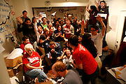 Volunteers cheer at Barack Obama's headquarters in Bloomington, Indiana on November 4, 2008 - election night - as television news announces a small lead for Obama again McCain at the moment in this photograph.