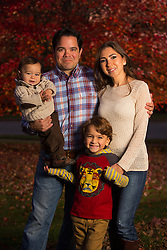 The Hinojosa family posed for a portrait at their home, Thursday, Nov. 07, 2013 at  in . <br /> <br /> The family just moved to Louisville two weeks ago from Texas for a job. <br /> <br /> Pictured are Ozil, 1, left, Omar, Octane, 5, and Erika.