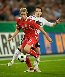 MONCHENGLADBACH, GERMANY - Wednesday, October 15, 2008: Wales' David Edwards and Germany's Piotr Trochowski during the 2010 FIFA World Cup South Africa Qualifying Group 4 match at the Borussia-Park Stadium. (Photo by David Rawcliffe/Propaganda)