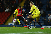 Birmingham City midfielder Jacques Maghoma  takes on Blackburn Rovers goalkeeper, Jason Steele (30) during the Sky Bet Championship match between Blackburn Rovers and Birmingham City at Ewood Park, Blackburn, England on 8 March 2016. Photo by Pete Burns.