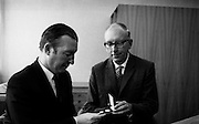 Minister for Finance Charles Haughey is formally presented with the first of Ireland's new decimal coins by Dr T K Whitaker, Governor of the Central Bank..03.09.1969, T.K. Whitaker,
