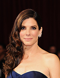 March 02, 2014 - Hollywood, California, U.S. - SANDRA BULLOCK, nominated for an Oscar for best actress in a leading role for her work in 'Gravity' arrives wearing a strapless navy Alexander McQueen gown at the 86th Academy Awards at the Dolby Theater..(Credit Image: © Lisa O'Connor/ZUMAPRESS.com)