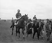 Irish Derby 1973 Irish Derby 1973 The Curragh Raccourse  --(Horse) Weavers' Hall –  Jockey is George McGrath, Lady leading in horse, I think is Rosemary McGrath but I will confirm that. <br />  <br /> The horse is trained by Seamus McGrath and owned by Seamus McGrath