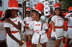 Young girls wearing majorette outfits laughing,