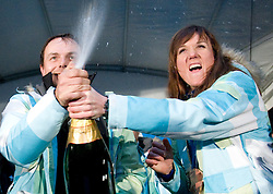Coach Ivan Hudac and Slovenian bronze medalist cross-country skier Petra Majdic with champaign at reception at her home town Dol pri Ljubljani after she came from Vancouver after Winter Olympic games 2010, on March 1, 2010 in Dol pri Ljubljani, Slovenia. (Photo by Vid Ponikvar / Sportida)