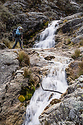 Hike by outlet stream of Lake/Lago Churup, Cordillera Blanca, Andes Mountains, Peru, South America. Near Huaraz, day hike 630 meters vertically up a steep trail to Lake/Lago Churup (4465 meters elevation).