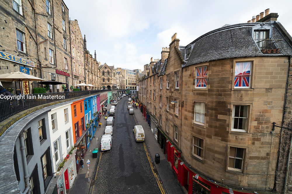 Elevated wide angle view of historic Victoria Street in Edinburgh Old Town, Scotland, UK