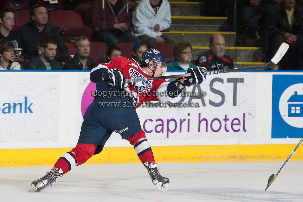KELOWNA, CANADA - MARCH 23: Jessey Astles #41 of the Tri-City Americans takes a shot on net against the Kelowna Rockets on March 23, 2014 at Prospera Place in Kelowna, British Columbia, Canada.   (Photo by Marissa Baecker/Shoot the Breeze)  *** Local Caption *** Jessey Astles;