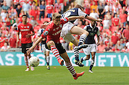 Lloyd Isgrove of Barnsley does battle with Shane Ferguson of Millwall during the Sky Bet League 1 Play-off Final between Barnsley and Millwall at Wembley Stadium, London<br /> Picture by Richard Blaxall/Focus Images Ltd +44 7853 364624<br /> 29/05/2016