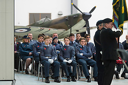 © Licensed to London News Pictures. 08/11/2015. Duxford, UK. Air cadets watch An official service of Remembrance and wreath laying ceremony taking place in front of a spitfire plane at Imperial War Museum Duxford, Cambridgeshire on Remembrance Sunday 2015. . Photo credit: Ben Cawthra/LNP