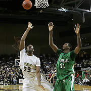 Central Florida forward Keith Clanton (33) shoots the ball by Marshall center Nigel Spikes (11) during a Conference USA NCAA basketball game between the Marshall Thundering Herd and the Central Florida Knights at the UCF Arena on January 5, 2011 in Orlando, Florida. Central Florida won the game 65-58 and extended their record to 14-0.  (AP Photo/Alex Menendez)