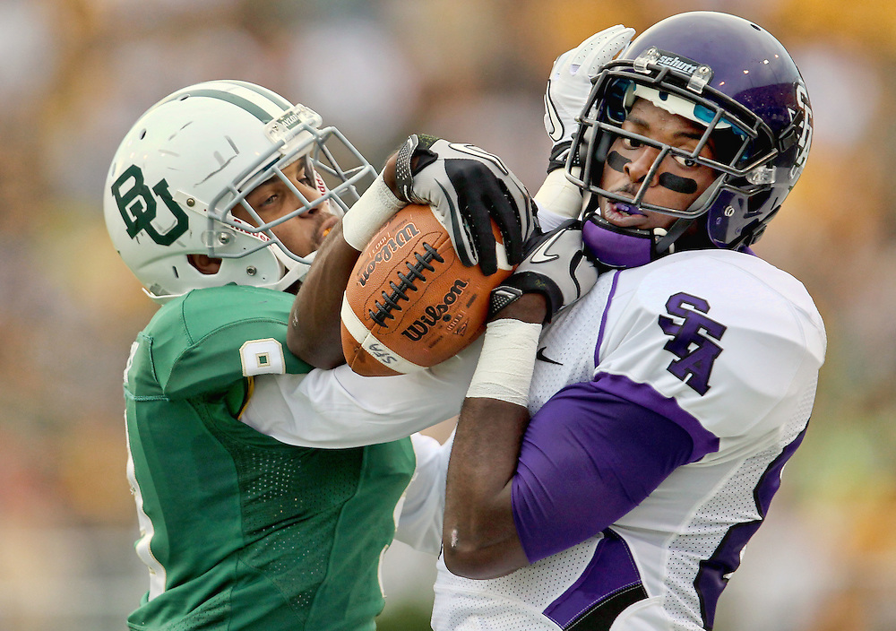 Stephen F. Austin wide receiver Cordell Roberson (80) comes down with a pass in front of Baylor cornerback Chance Casey (9) during an NCAA college football game, Saturday, Sept. 17, 2011, in Waco, Texas. Baylor won 48-0.