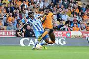Dominic Iorfa and Kazenga LuaLua tussle for the ball during the Sky Bet Championship match between Wolverhampton Wanderers and Brighton and Hove Albion at Molineux, Wolverhampton, England on 19 September 2015. Photo by Alan Franklin.